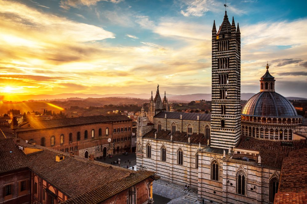 A sunset view of Siena with the Duomo   Best towns to visit in Tuscany   Tuscan Wanders Travel Blog