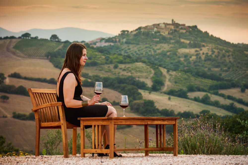 Girl drinking wine in a Tuscan Landscape   Drinking and driving in Italy