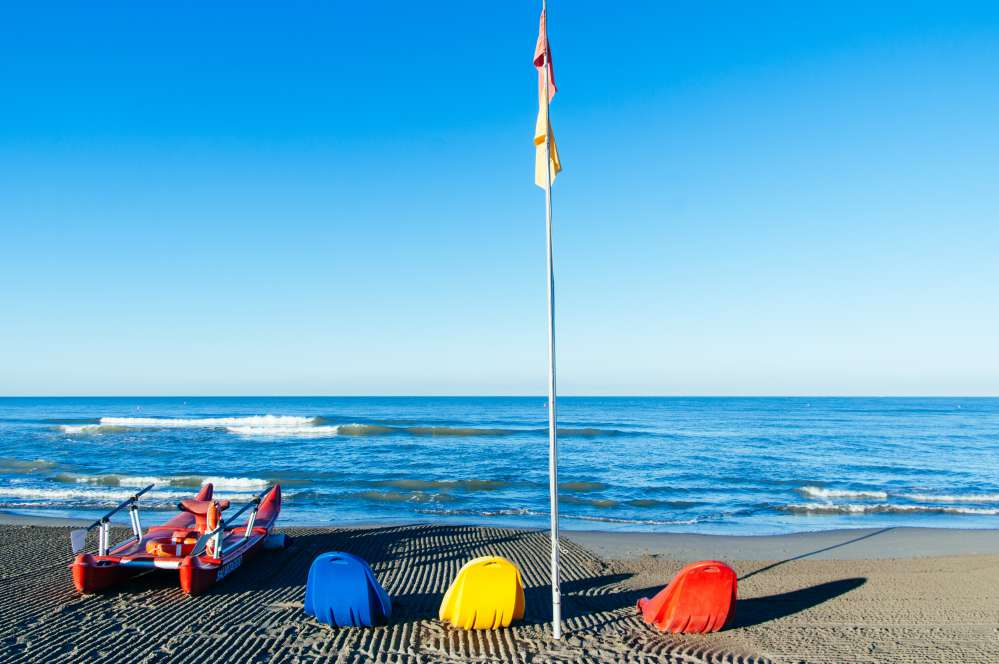 A beach in Forte dei Marmi with the typical rescue boat | Beaches near Florence
