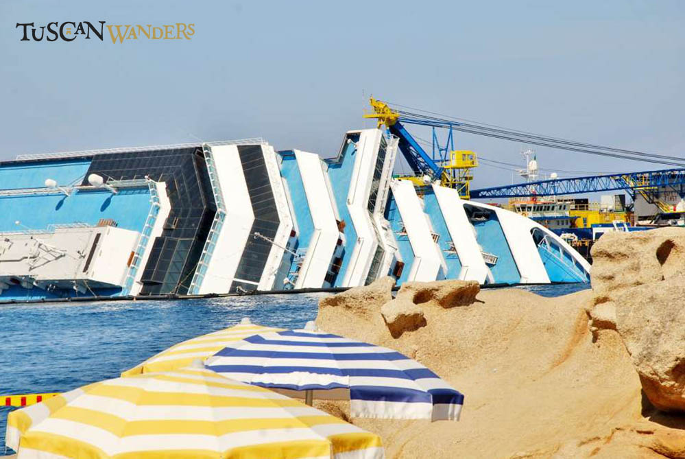 Costa Concordia shipwreck with beach umbrella