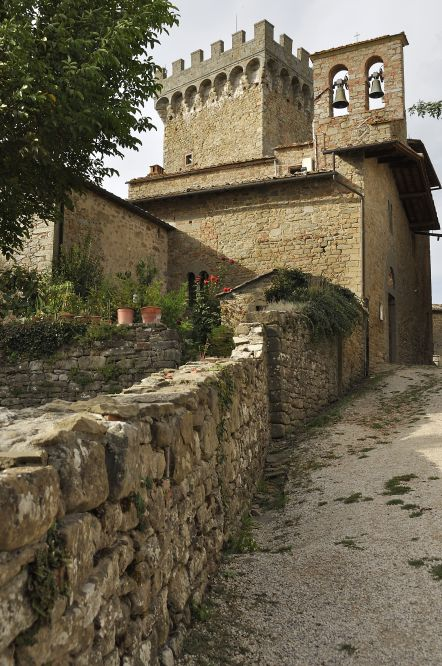 The stony mass of the Castle of Gargonza seen from down the hallway