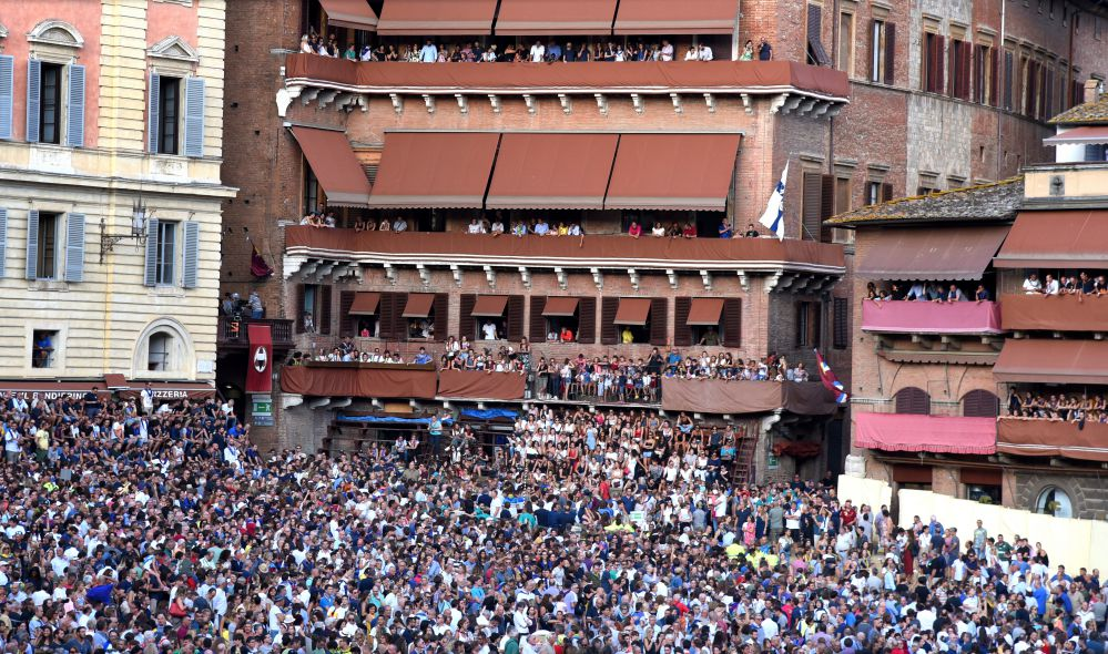 Piazza del Campo, Siena crowded with people during Palio horse race