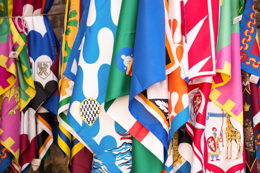 Flags of the Siena contrade (districts), Palio festival background, in Siena, Tuscany, Italy