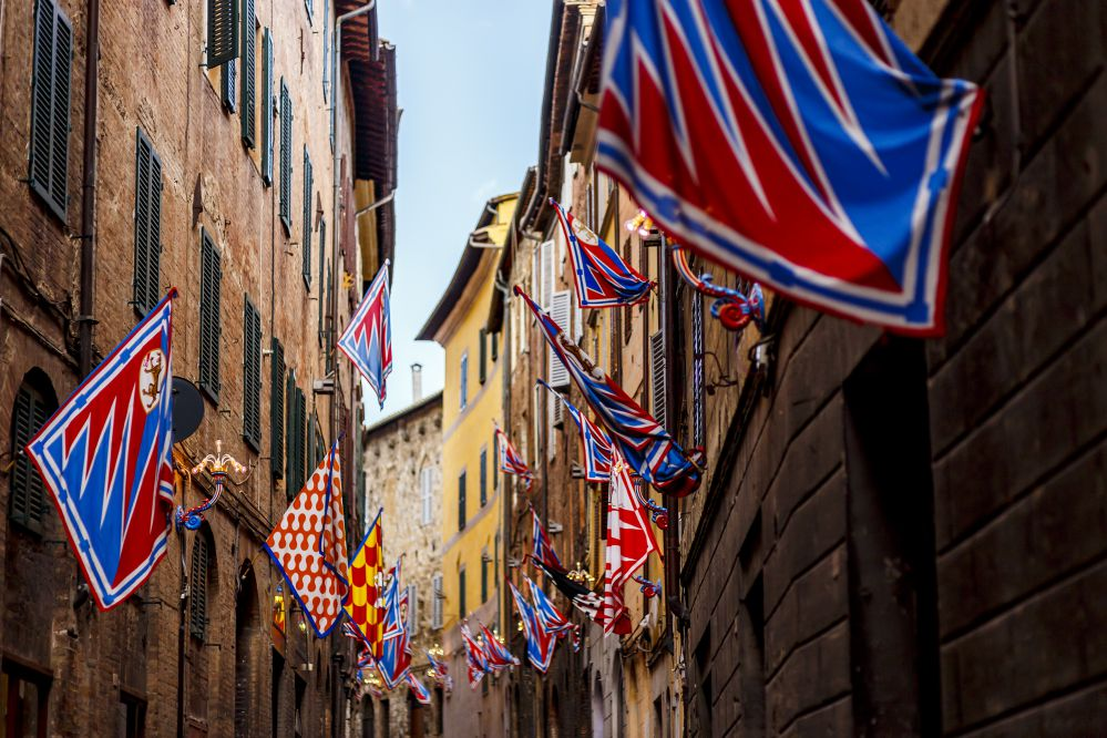 Flags of the Siena contrade (districts), hanging on city walls