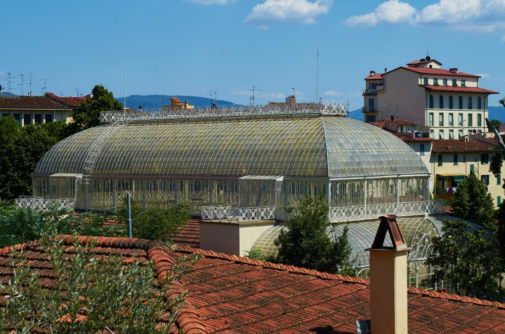 Panorama of the grenhouse of the Orticoltura garden in Florence with view of Florence roofs