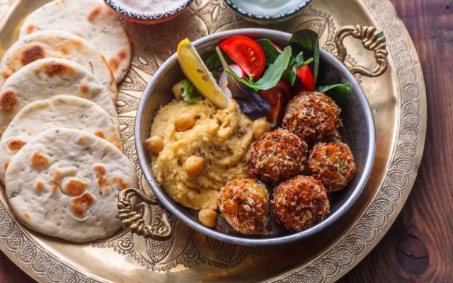 Hummus, falafel, salad and pita. Jewish food has many dishes in common with arabic