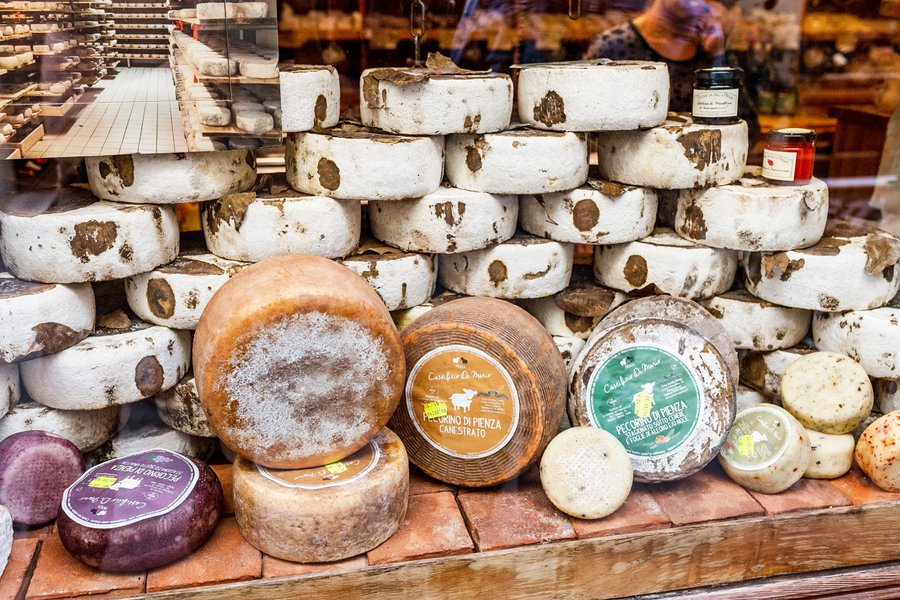 Different types of Pienza pecorino on a stand during the Cheese Festival