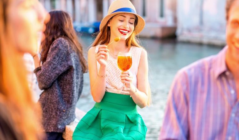 Young girl drinking aperitivo in Italy