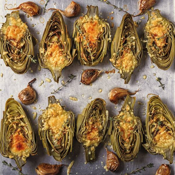 A plate full of baked artichokes